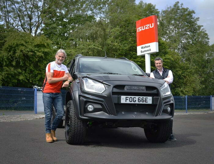 "Former motorbike racing world champion Carl Fogarty has collected the keys to his new Isuzu D-Max XTR from Walton Summit Truck Centre in Lancashire. Featuring a custom designed body kit, a sophisticated and sporty interior, performance brakes and a bespoke Pedders suspension arrangement, the XTR is the perfect fit for the adrenaline-filled petrolhead. Renowned for his high corner speed riding style, Carl raced to victory on 59 occasions in the World Superbike Championships – picking up four world titles in the process – making him one of the most decorated riders of all-time. With its energetic appearance and enhanced off-road capabilities, the Isuzu D-Max XTR complements Carl's action-packed lifestyle. In terms of performance, XTR is equipped with a bespoke Pedders suspension and brake system making it extremely comfortable on the road and capable in the extreme off-road. Vented and slotted front brake discs offer excellent heat dissipation and work in combination with the Kevlar ceramic front brake pads for remarkable braking performance. The 17-inch satin black alloy wheels have a heavy duty, rigid design and are fitted with Pirelli Scorpion All-Terrain Plus tyres that provide traction in challenging conditions. XTR offers substantial kerb appeal with a dramatic front bumper guard, bonnet protector and headlight frames. Imposing wheel arch extensions contribute to XTR's assertive stance and the angular bar framework on the XTR side steps are designed to prevent rocks and stones damaging the bodywork. To personalise his truck, Carl has chosen an optional XTR Style Pack, consisting of Black Mountain Top Roller Cover, Black Sports Bars and Black Roof Bars. Inside the cab, Carl will be travelling in style as the D-shaped sports steering wheel and XTR heated front sports seats are trimmed in leather and suede with contrast green overstitching. The interior of this six-speed automatic XTR is packed with convenient equipment, including a 7-inch Multifunction Colour Touchscreen, Bluetooth, Front & Rear USB Ports and a Reversing Camera. For even more visibility, Carl has also opted for a Front Camera. Carl collected his XTR from the family-run Walton Summit Truck Centre near Preston in Lancashire. Many Isuzu customers are key workers so Walton Summit's workshop has remained open to provide maintenance and repairs for essential services during lockdown. They're continuing to implement social distancing and enhanced hygiene practices now their sales showroom has re-opened, including regular sanitisation of surfaces and vehicles, the provision of protective equipment and the removal of non-essential items like magazines in the waiting room. They have a new vehicle handover procedure designed to protect the health and wellbeing of customers which meant that Carl's collection appointment was scheduled in advance. He was asked to wash his hands upon arrival and maintain a safe 2 metre distance at all times. Once Carl signed the paperwork using his own pen, he was presented with a tray containing the disinfected keys to his new Isuzu D-Max XTR. Carl Fogarty remarked: ""I love anything with an engine and I live for the outdoors, so the XTR suits me down to the ground. It's got real character and stands out from a crowd, which is great in an age where cars are increasingly looking the same. Can't wait to take it off-road!"" Nigel Perplus, Commercial Director at Walton Summit Truck Centre added: ""Foggy is a motorcycle racing legend so XTR is clearly the perfect truck for him. We want him to focus on enjoying his new pick-up so we've worked very hard to put procedures in place that ensure a safe handover environment at Walton Summit because our top priority is the protection of our staff and customers."" William Brown, Managing Director at Isuzu UK, commented: ""Having a world champion superbike rider choose the XTR speaks volumes. It has been engineered to the highest standards and has been built with true motoring enthusiasts like Carl in mind."" The Isuzu D-Max XTR sits alongside the Blade and Arctic Trucks AT35 in the 'Adventure' range, and an XTR 'Colour Edition' upgrade was added in June. All Isuzu D-Max models achieve the Euro 6 emission standard without the need for AdBlue, are covered by a 125,000 mile / 5-year warranty (whichever comes first) and 5-year roadside assistance in the UK and across Europe."